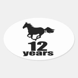 12 anos de design do aniversário adesivo oval