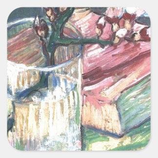 A amêndoa de florescência ramifica em um vidro e adesivo quadrado