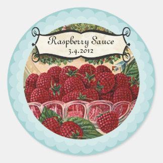 A bacia de framboesas frutifica etiqueta de adesivo redondo