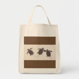 a bolsa de compra com as três tartarugas do bebê