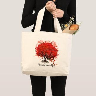 A bolsa de praia vermelha da lua de mel da árvore
