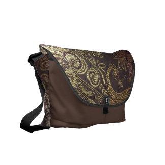 A bolsa mensageiro dourada de brocado