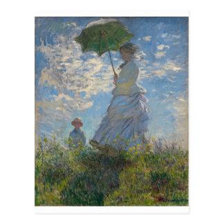 A caminhada, mulher com um parasol (1875) cartão postal