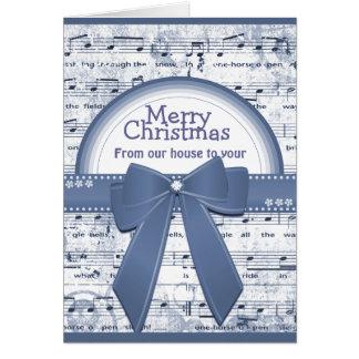 A fita azul do Feliz Natal nota o cartão