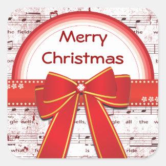 A fita vermelha do Feliz Natal nota a etiqueta Adesivo Quadrado