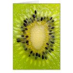 A fruta w do verde do quivi semeia o fundo cortado cartões