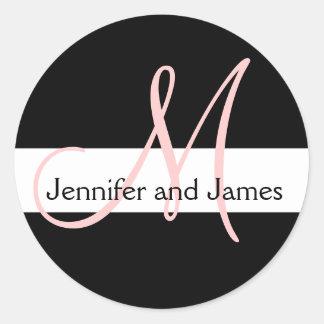 A inicial do monograma do casamento nomeia o preto adesivo