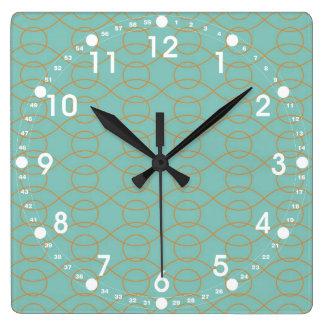 A laranja azul moderna elegante circunda listras o relógios de pendurar