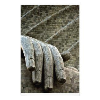A mão da pedra papelaria