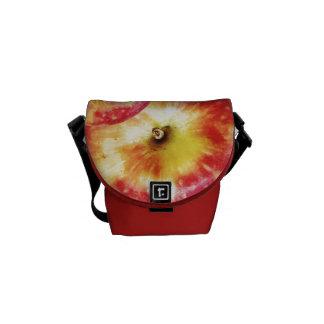 A mini bolsa mensageiro vermelha de Apple