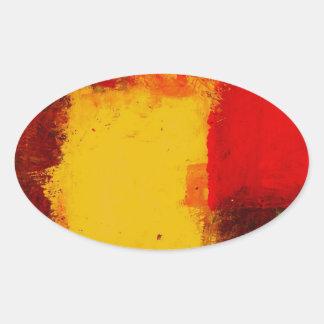Abstrato vermelho do amarelo adesivo oval
