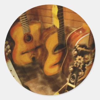 Aguarela das guitarra adesivos em formato redondos