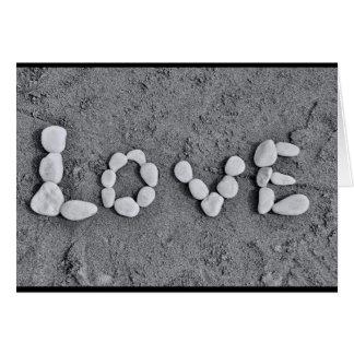 Amor nos seixos cartão
