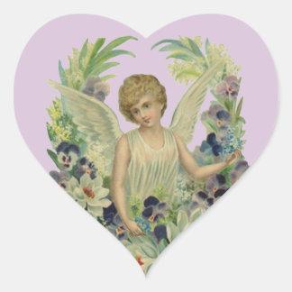 Anjo antigo da etiqueta no coração floral das adesivo coração