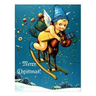 Anjo bonito no Feliz Natal do cavalo de balanço do Cartão Postal