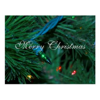 Árvore do Feliz Natal e cartão das luzes Cartão Postal