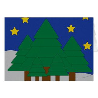 Árvores e cartão cortados papel do feriado da neve