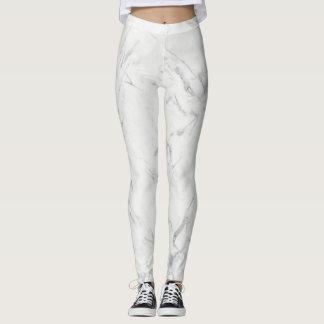 As calças de mármore das caneleiras alisam leggings