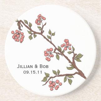 As flores de cerejeira cor-de-rosa personalizaram  porta copos de arenito