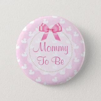 As mamães a ser arco cor-de-rosa e patinhos de bóton redondo 5.08cm