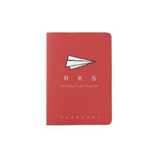 avião de papel com vermelho do viagem do monograma capa para passaporte