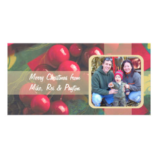 Bagas do azevinho e cartão com fotos da família da