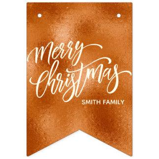 Bandeirinha Tipografia do Feliz Natal no ouro cor-de-rosa do