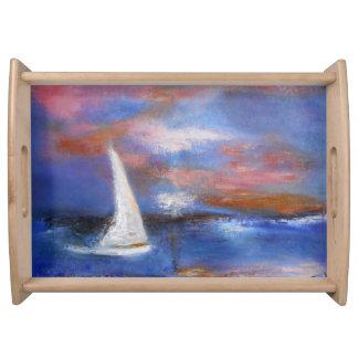 Bandeja do serviço da vela do por do sol do porto