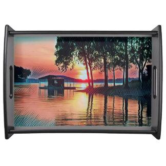 Bandeja O pêssego lindo colore o por do sol no lago