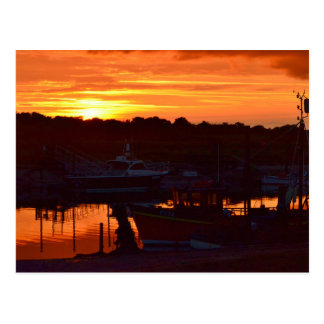 Barcos no por do sol cartão postal