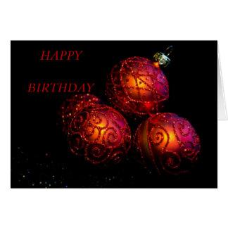Baubles vermelhos festivos cartão comemorativo