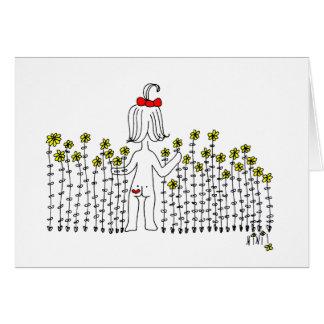 Bebê em um campo das flores cartão comemorativo