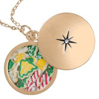 Biscoitos de açúcar caseiros decorados do Natal do Colar Medalhão