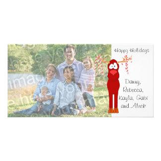 Boas festas cartão com fotos do bastão da rena e d cartão com foto