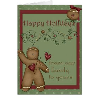Boas festas cartão dos homens de pão-de-espécie