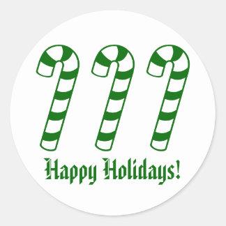 Boas festas etiquetas verdes do bastão de doces