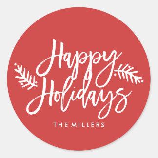 Boas festas feriado indicado por letras da mão adesivo