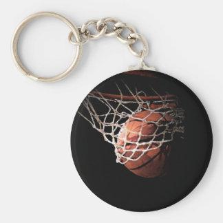 Bola do basquetebol na ação chaveiro
