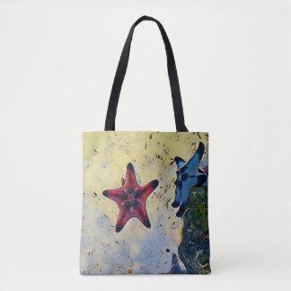 Bolsa Tote Estrela do mar azul vermelha artística na areia