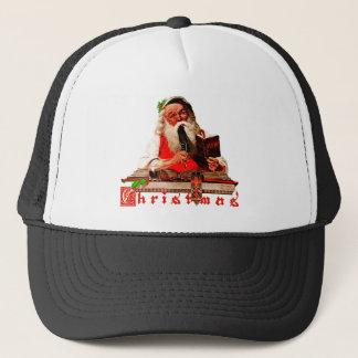 Boné Papai Noel verifica sua lista