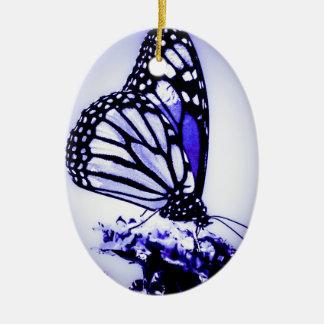 Borboleta de monarca, azul - ornamento de cerâmica oval