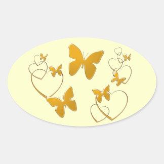 Borboletas e corações alaranjados macios adesivo oval
