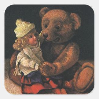 Brinquedos do natal vintage, boneca e um urso de adesivo quadrado