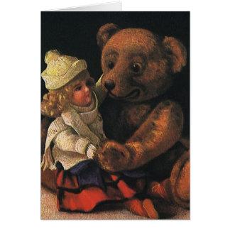 Brinquedos do natal vintage, boneca e um urso de cartão comemorativo