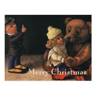Brinquedos do natal vintage, boneca e um urso de cartão postal