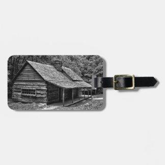 Cabine nas madeiras etiqueta de bagagem