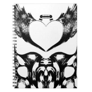 Caderno preto e branco do coração do anjo