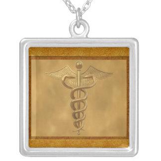 Caduceus médico do ouro bijuterias