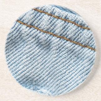 Calças de ganga desvanecida porta copos de arenito
