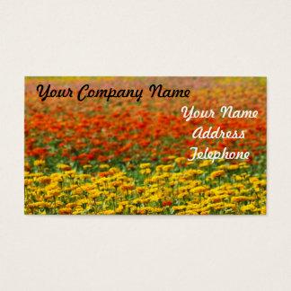 Cama de flor vermelha e amarela do cartão de visitas